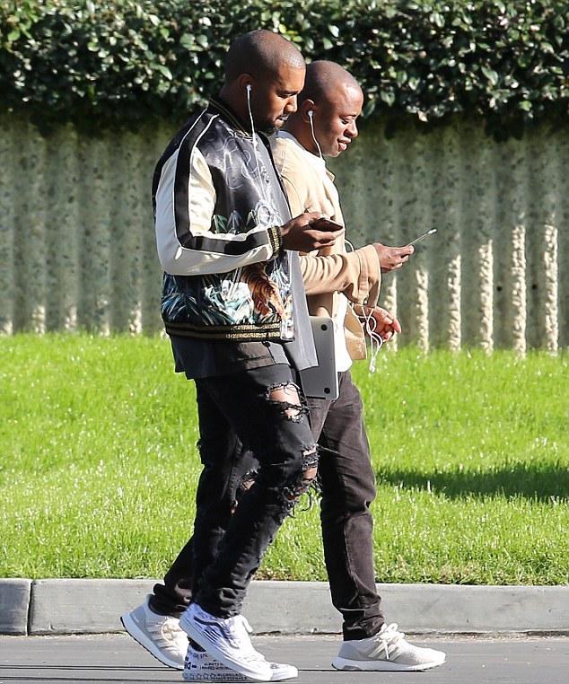 Spotted: Kanye West In Saint Laurent Jacket & Vans