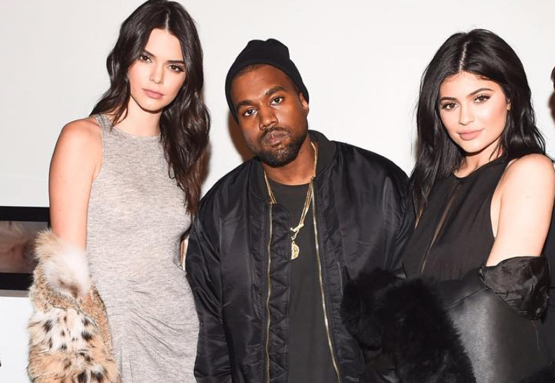 Kanye West With Kylie & Kendall Wears Alpha Industries Jacket, Maison Margiela Pants And New Yeezy Boost Sneakers