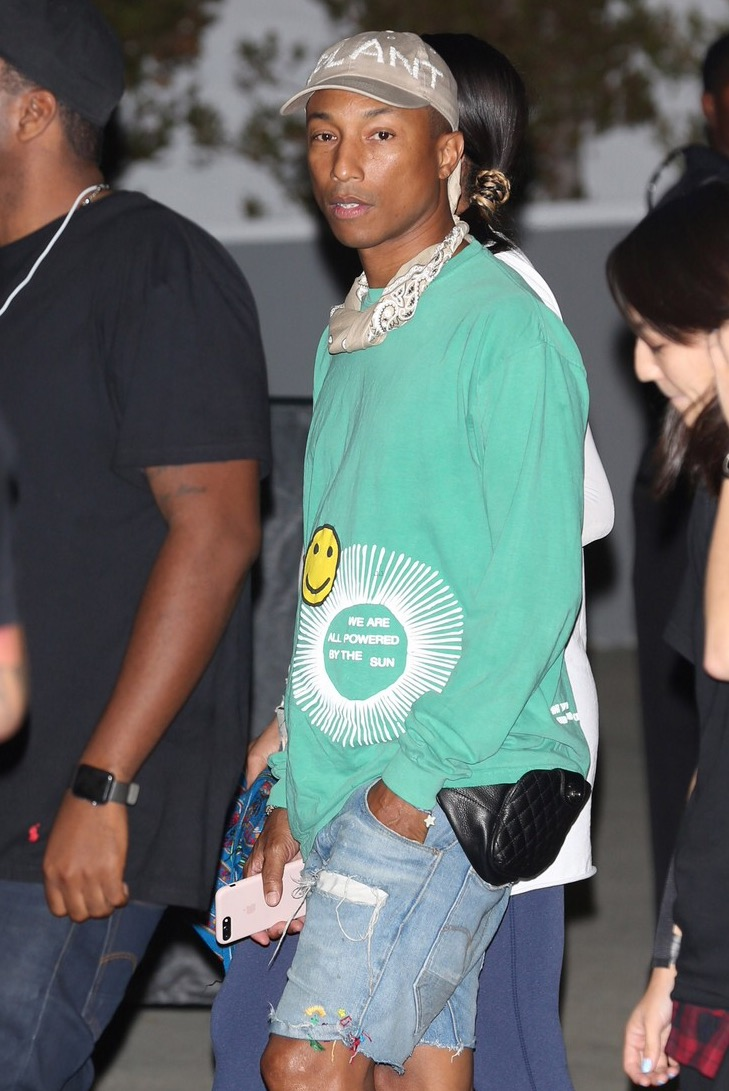Spotted: Pharrell Williams seen wearing pink Timberland boots and Chanel fannypack