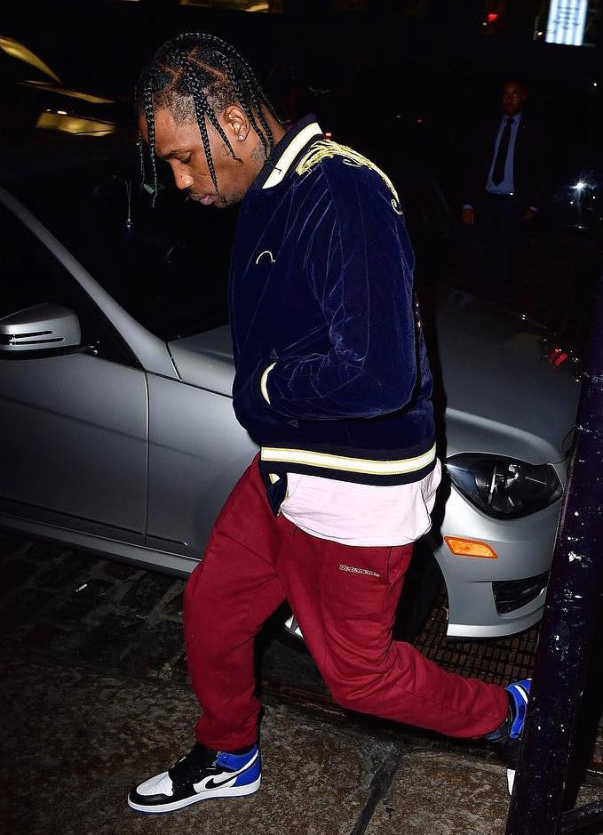 Spotted: Travis Scott In Vetements Sweatpants & Nike Air Jordan 1