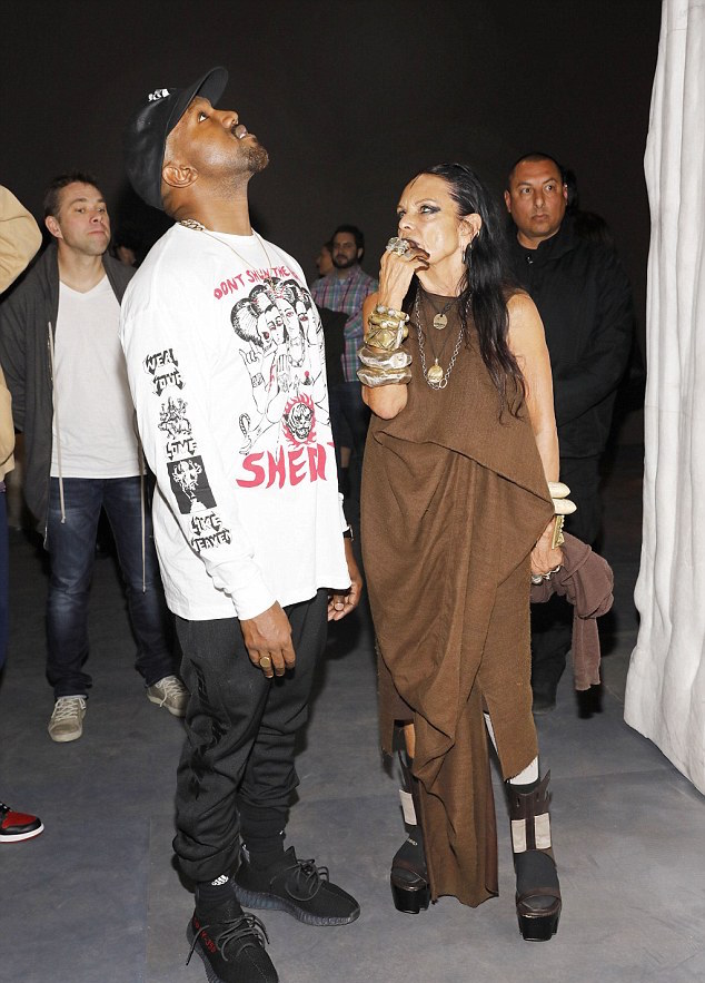 Kanye West At Rick Owens Exhibition In Yeezy Sweatpants and Sneakers