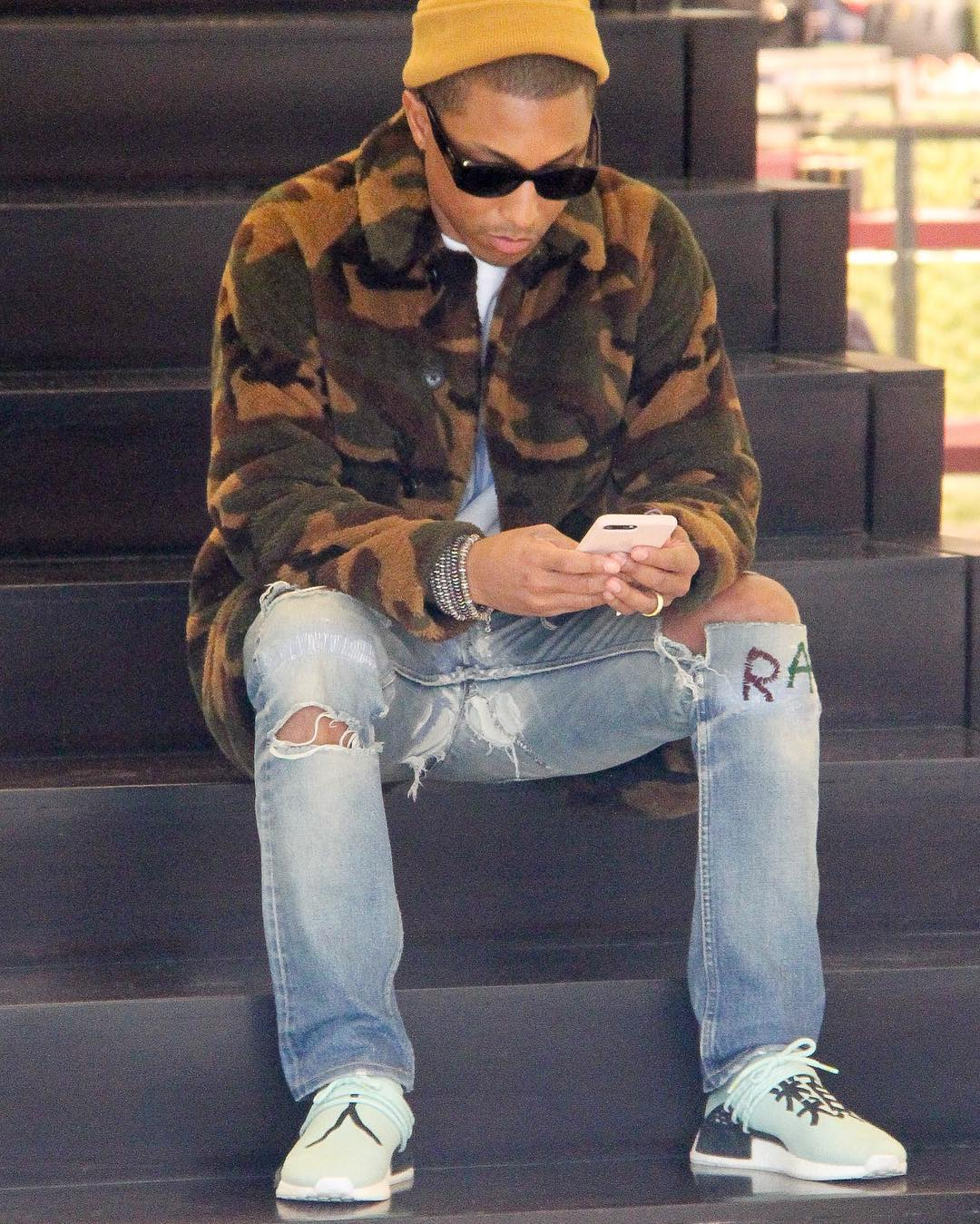 SPOTTED: Pharrell Williams In Camo Coat, Chanel Sunglasses And Adidas NMD's