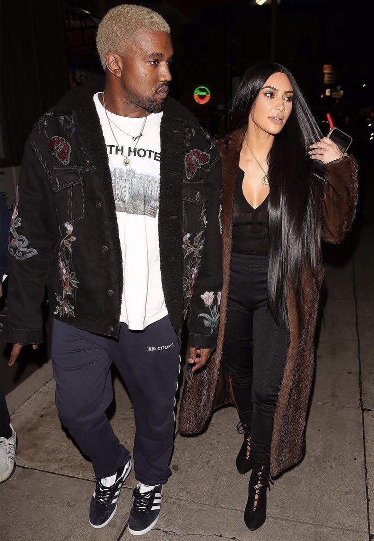 SPOTTED: Kanye In Yeezy Boost Sneakers And Gucci Jacket