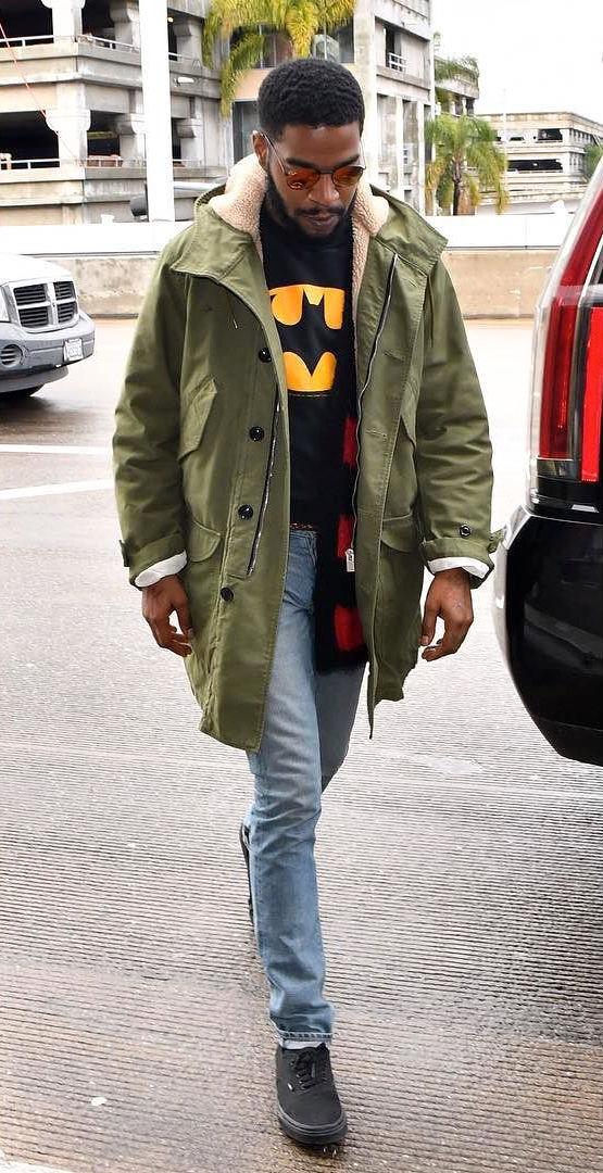 SPOTTED: Kid Kudi Wearing Saint Laurent Parka Coat, Cardigan, Vans and Ray Bans at LAX