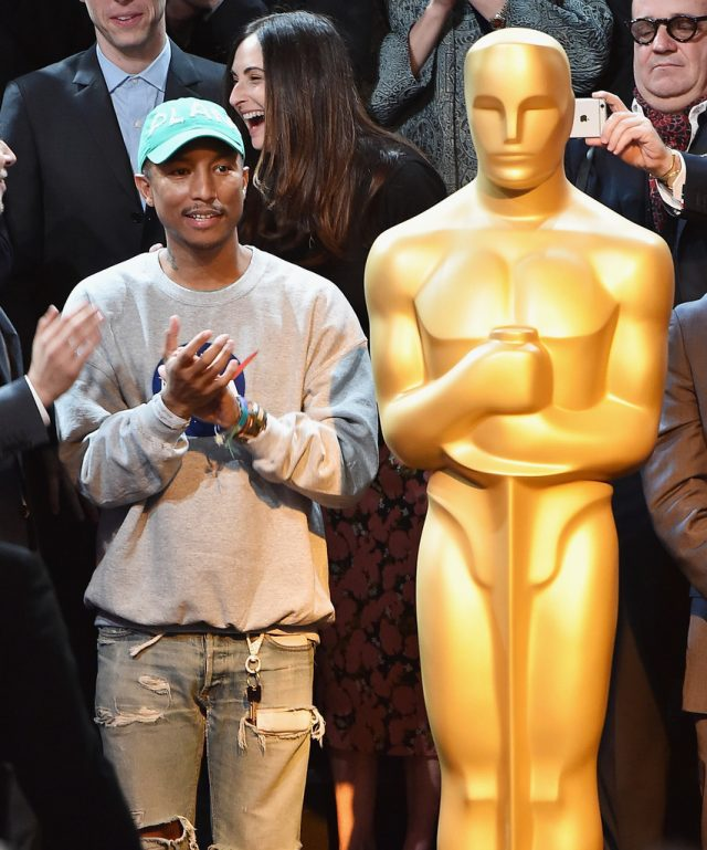 SPOTTED: Pharrell Williams in C.P.F.M Cap, NASA Jumper, G-Star Raw Jeans and Timberlands at Oscar Luncheon
