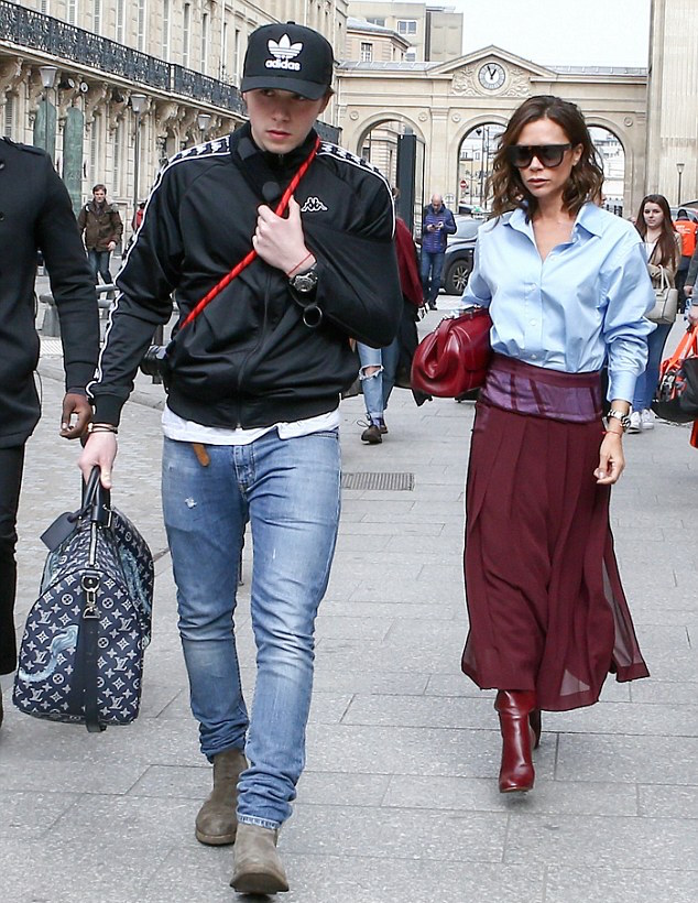 SPOTTED: Brooklyn Beckham In Kappa Jacket & Louis Vuitton Bag