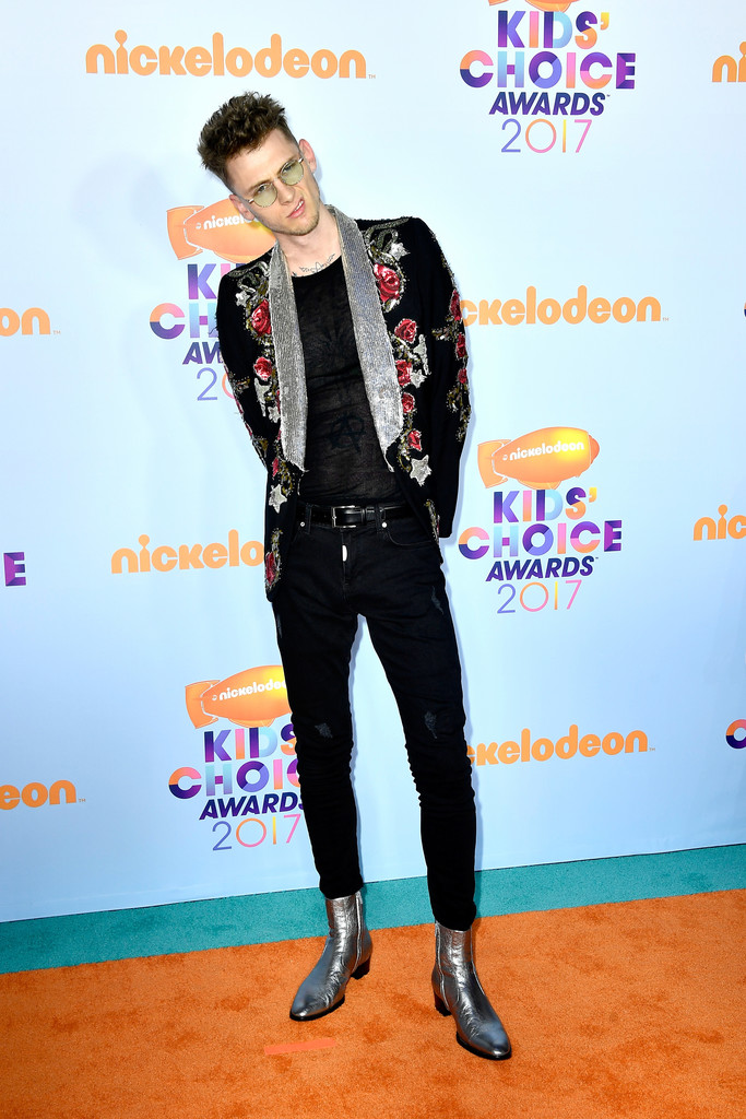 SPOTTED: Machine Gun Kelly At The Kid's Choice Awards In Roberto Cavalli Jacket And Saint Laurent Boots