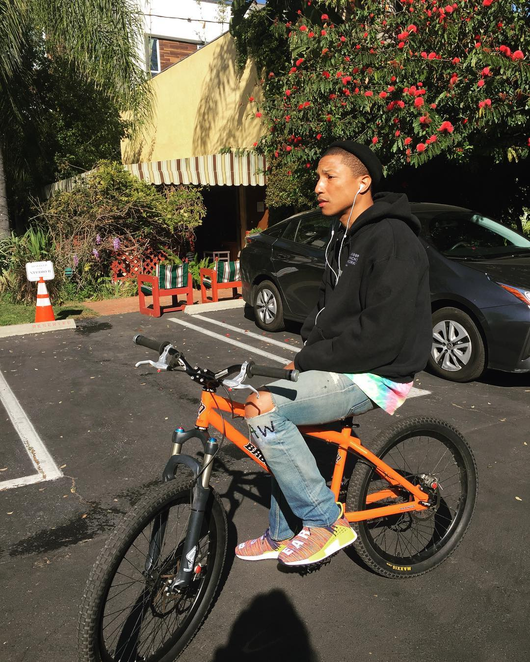 SPOTTED: Pharrell Williams Rides Brooklyn Machine Works Bike In Adidas NMD Body And Earth Sneakers