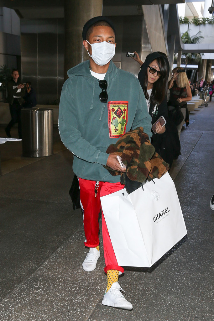 SPOTTED: Pharrell Williams In Bedwin And The Heartbreakers Camo Coat And Adidas Pants And Sneakers