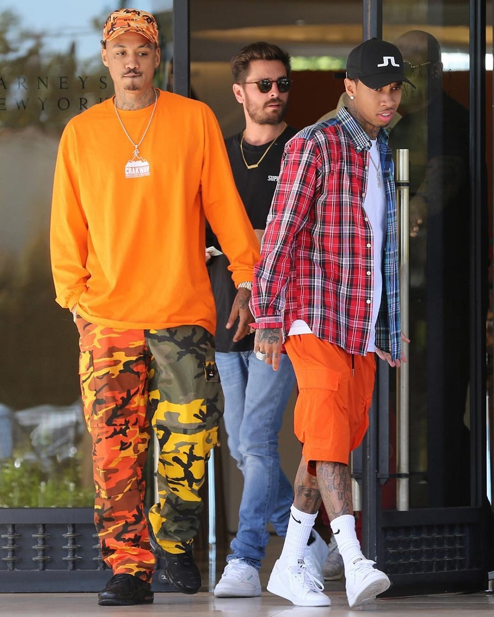 SPOTTED: Tyga in Palace Shirt, J Lindeberg Hat and Raf Simons x Adidas Sneakers