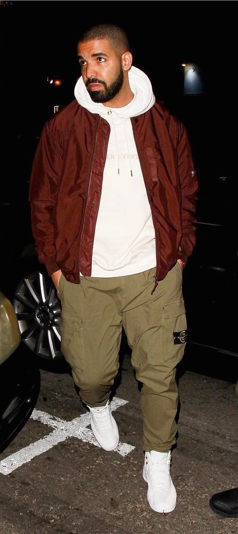 SPOTTED: Drake In OVO Hoodie And Sneakers, Stone Island Jacket And Pants