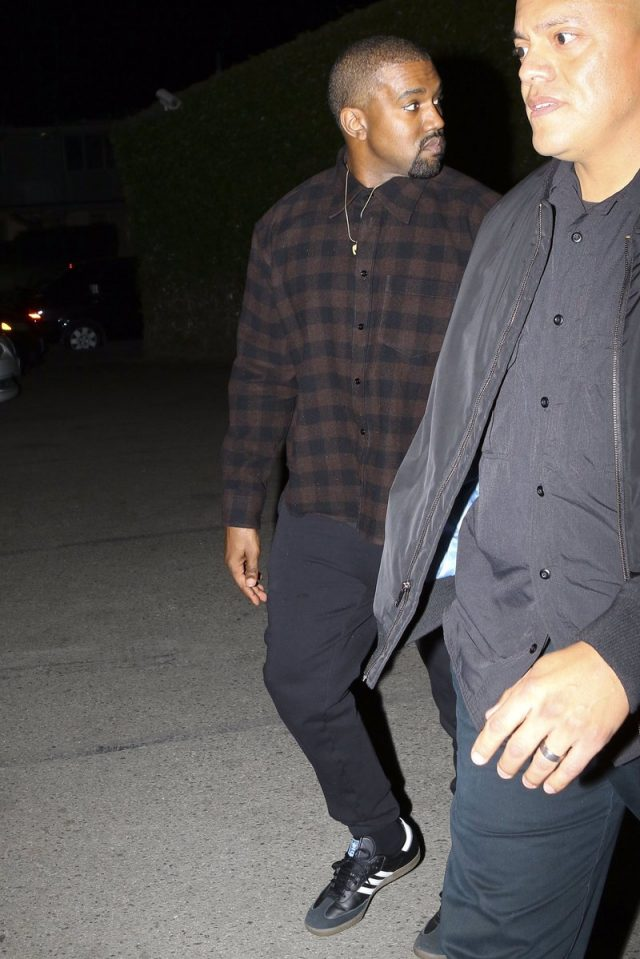 SPOTTED: Kanye West In Balenciaga Flannel Shirt and Adidas Samba Sneakers