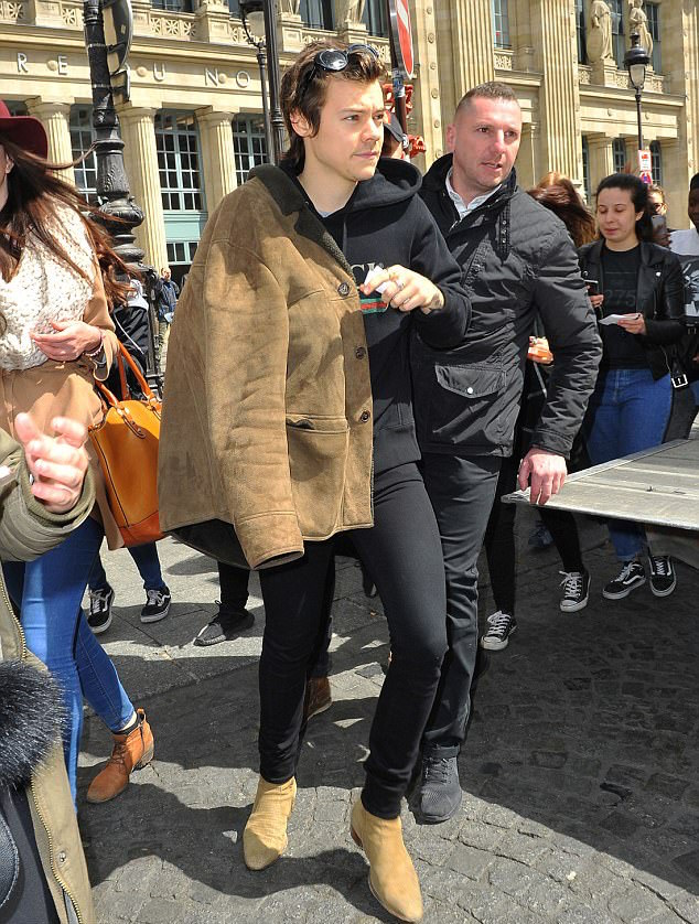 SPOTTED: Harry Styles in a Saint Laurent Shearling Coat, Boots and a Gucci Hoodie