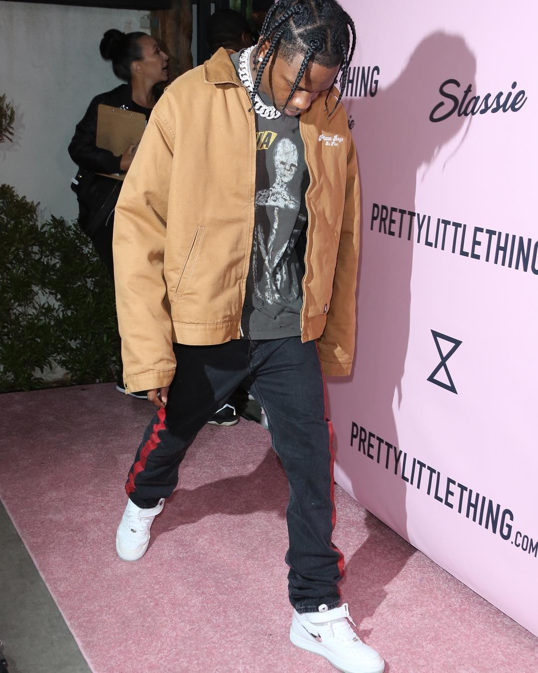 SPOTTED: Travis Scott in Pizza Boys Jacket, Balenciaga Jeans and Nike Sneakers