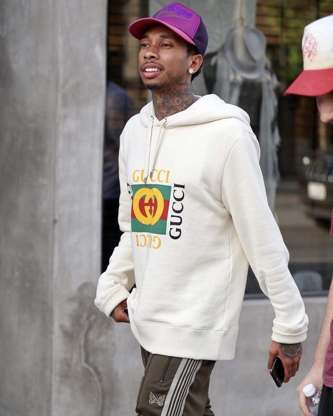 SPOTTED: Tyga in a Gucci Hoodie, Needles Track Pants and a BAPE Hat