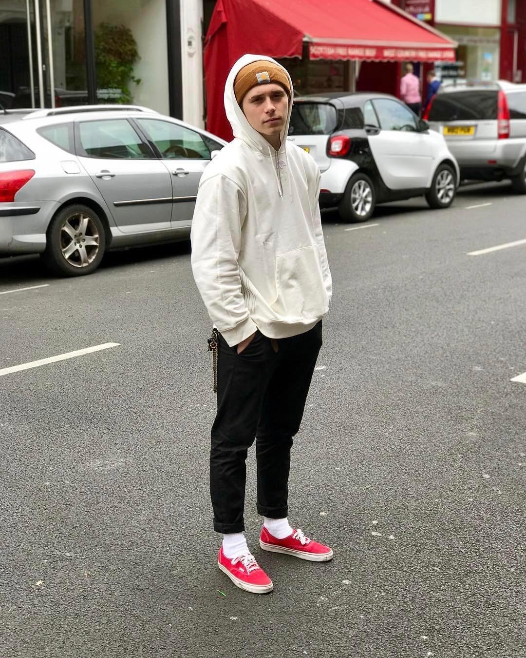 SPOTTED: Brooklyn Beckham In Alexander Wang x Adidas Hoodie And Vans Sneakers