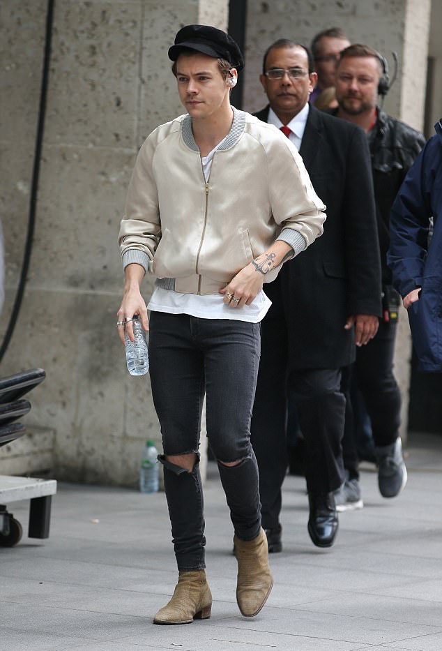 SPOTTED: Harry Styles In Harry Lambert Jacket And Saint Laurent Jeans And Boots