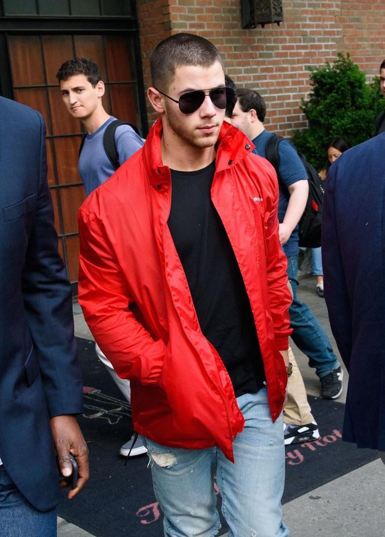 SPOTTED: Nick Jonas In Red Balenciaga Jacket