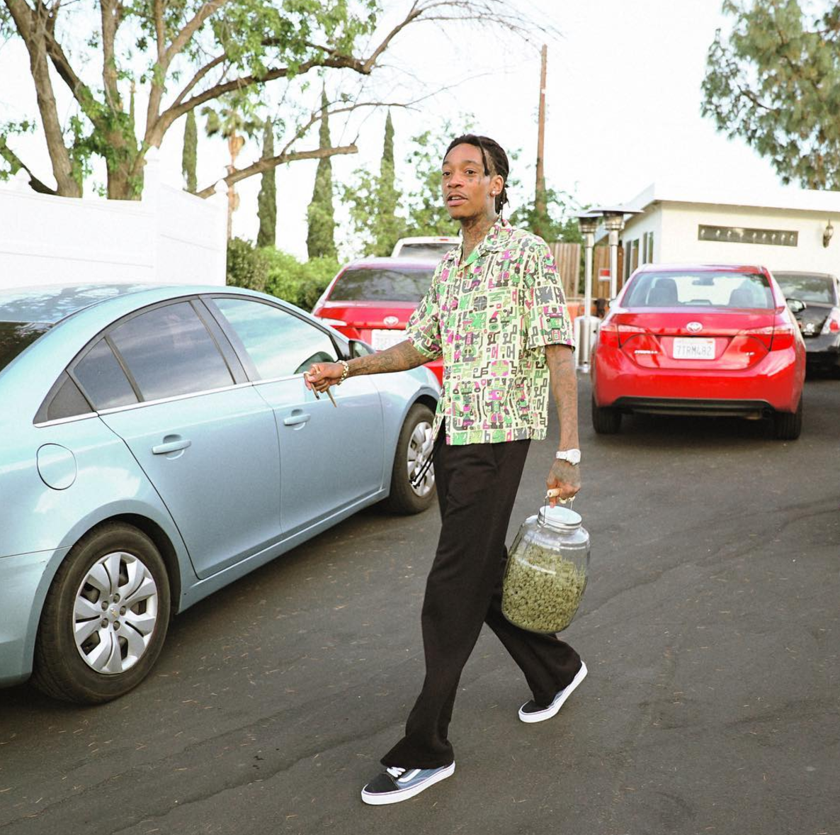 SPOTTED: Wiz Khalifa In Green Shirt And Old Skool Vans