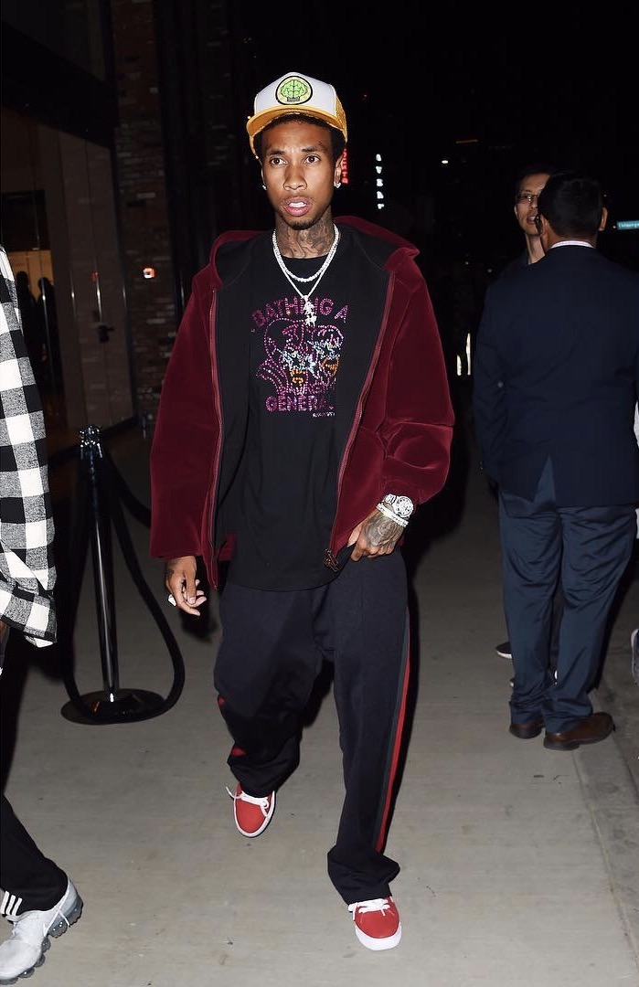 SPOTTED: Tyga In NERD Neptunes Hat, Bape T-Shirt and Gucci Trousers