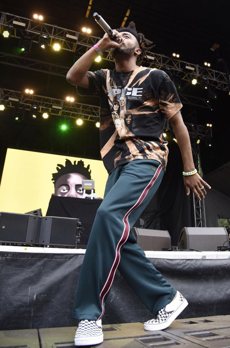 SPOTTED: Aminé at Lollapalooza In Spice Girls T-Shirt And Vans Sneakers