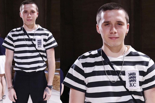 SPOTTED: Brooklyn Beckham In Kent And Curwen T-Shirt, Dr Marten Boots And David Beckham In A Suit