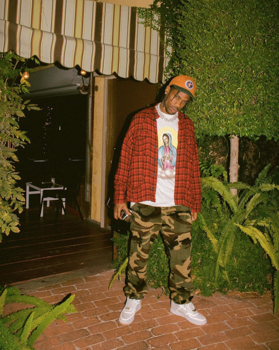 SPOTTED: Travis Scott In Supreme Pledge Allegiance 6-Panel Cap, Flannel Shirt And Nike Sneakers
