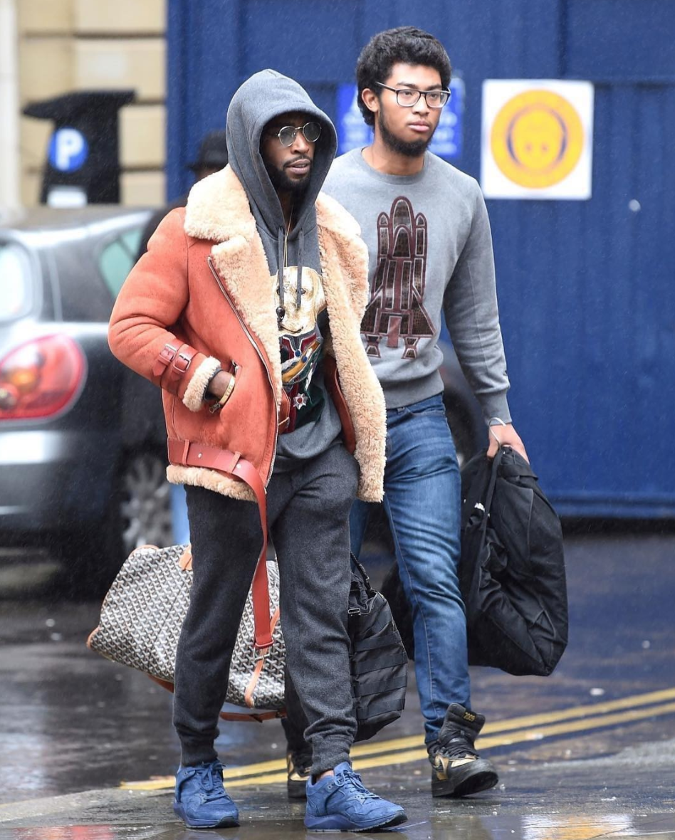 SPOTTED: Tinie Tempah In Acne Studios Shearling Jacket, Dolce & Gabbana Hoodie And Filling Pieces Sneakers