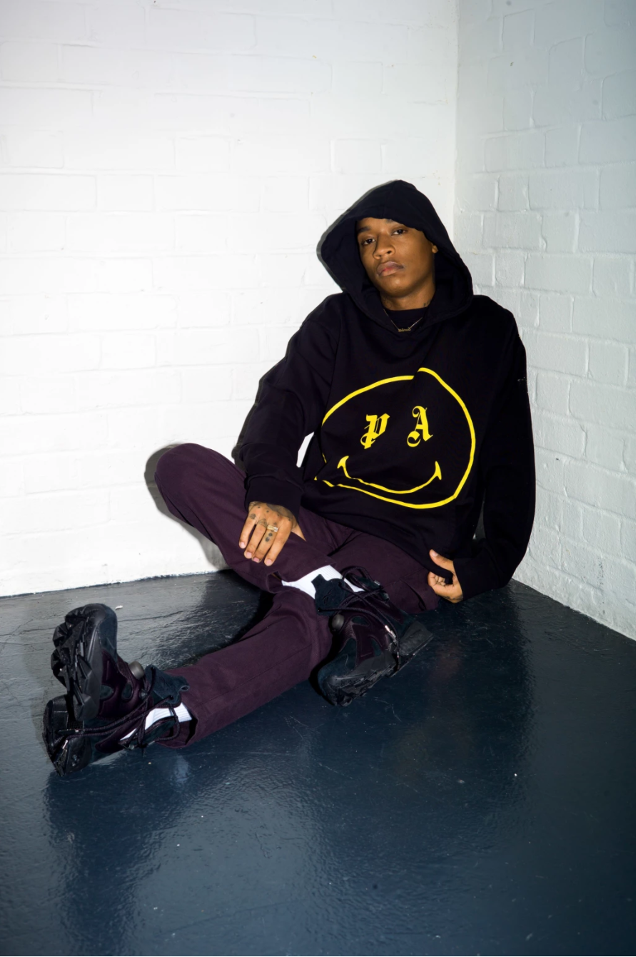 Rejjie Snow Sports Balenciaga, Acne Studios, Palm Angels and More While Exploring Topics with SSENSE