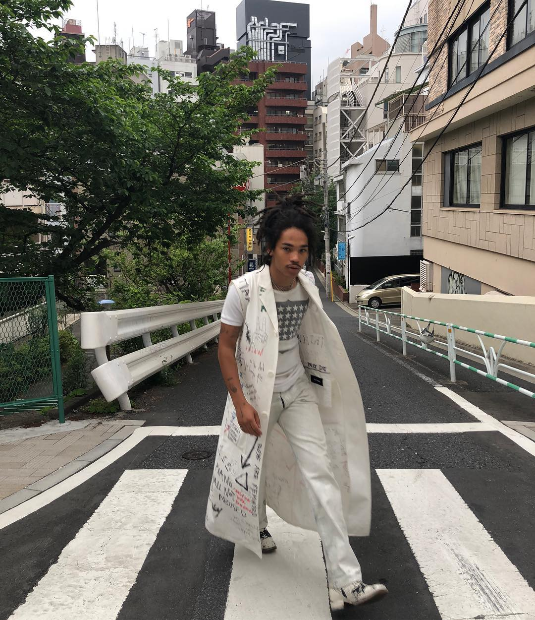 SPOTTED: Luka Sabbat Ties Raf Simons' Lab Coat into an All-White Fit