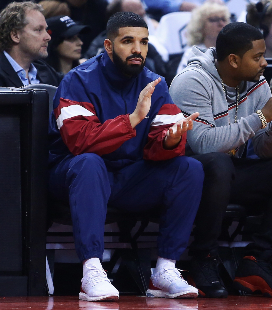 SPOTTED: Drake Sits Courtside in Balenciaga Tracksuit & adidas Trainers