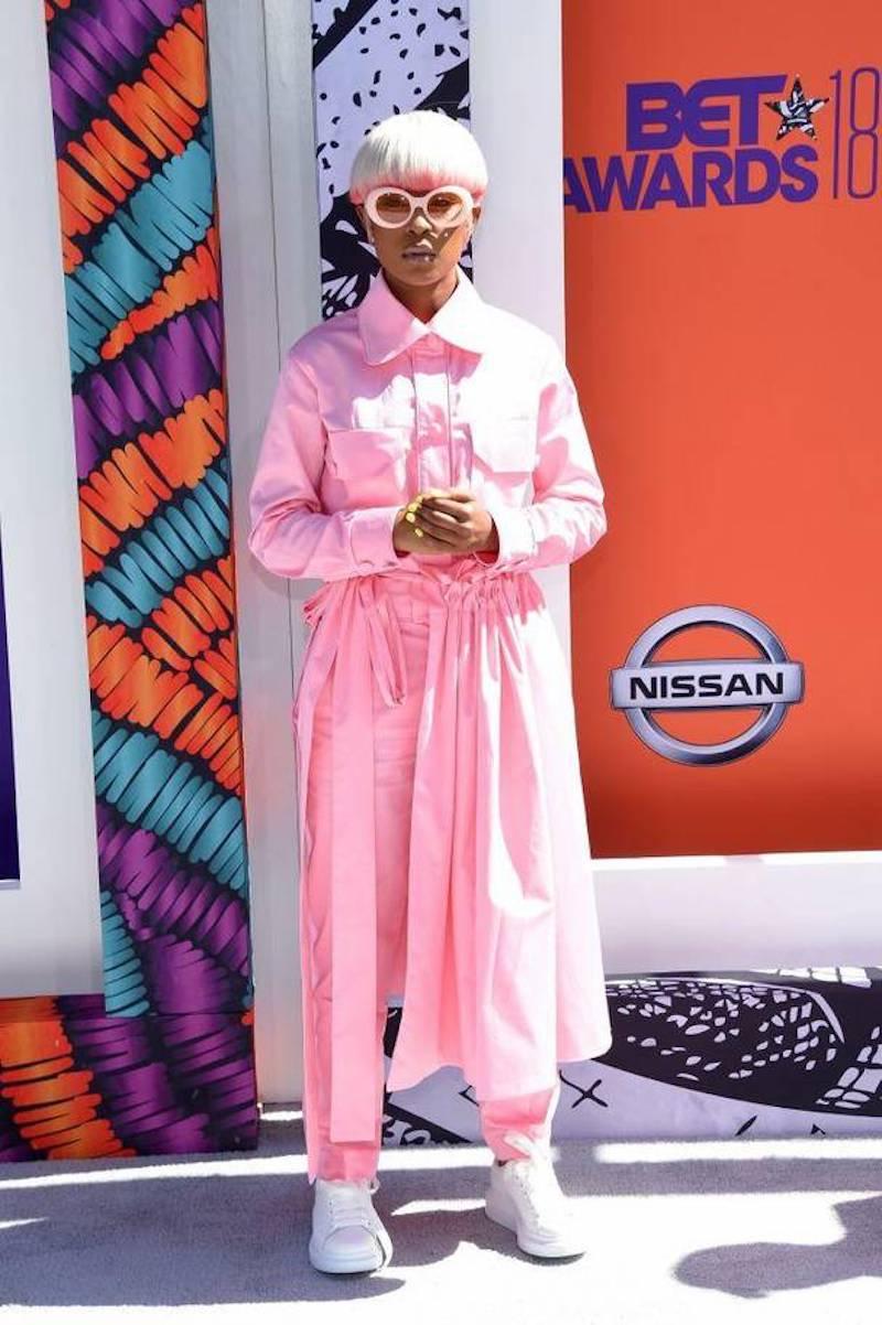 Dej Loaf in head to toe Millennial pink boiler suit & skirt combo
