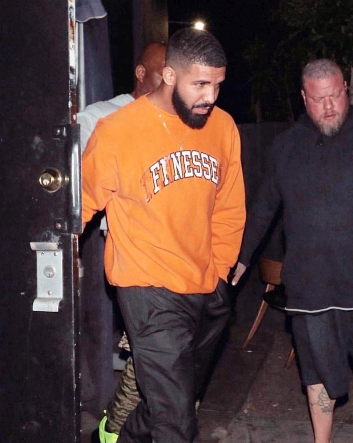 Drake in Orange Sweatshirt
