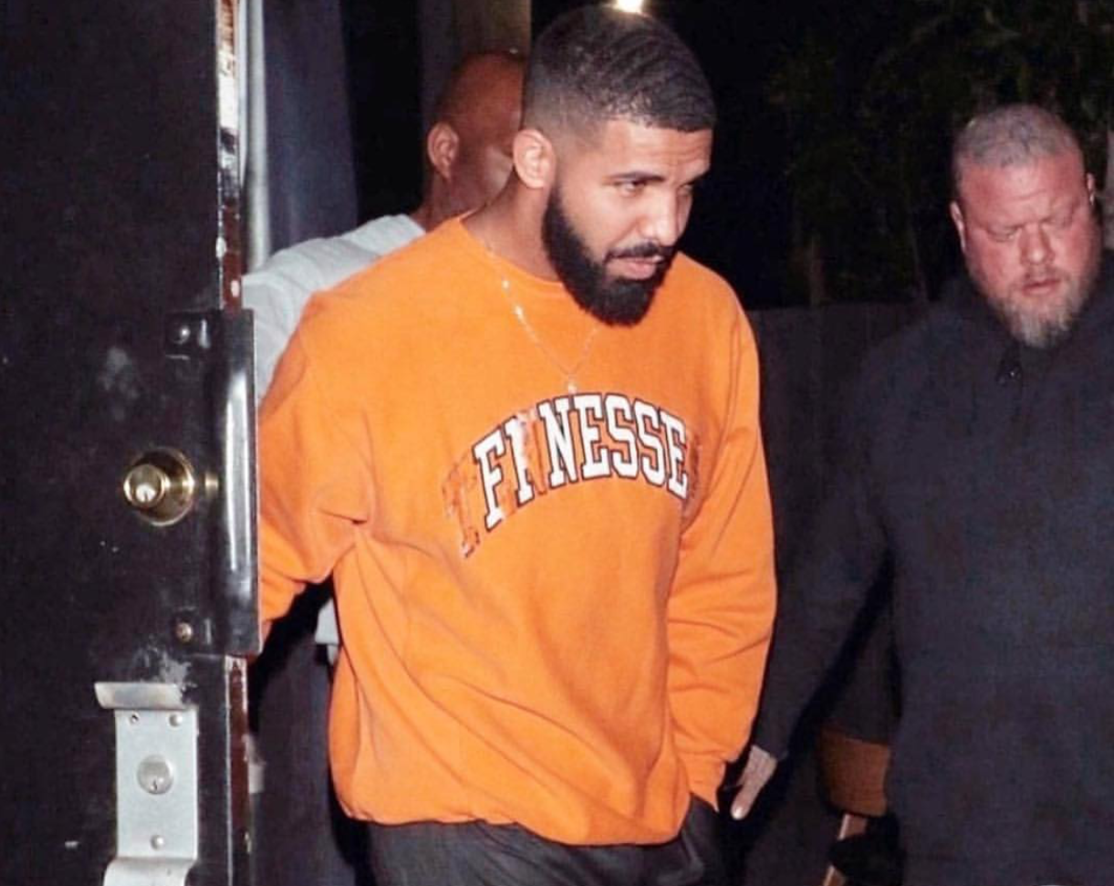 "SPOTTED: Drake Parties in Orange ""Finesse"" Sweatshirt & Black Track Pants"