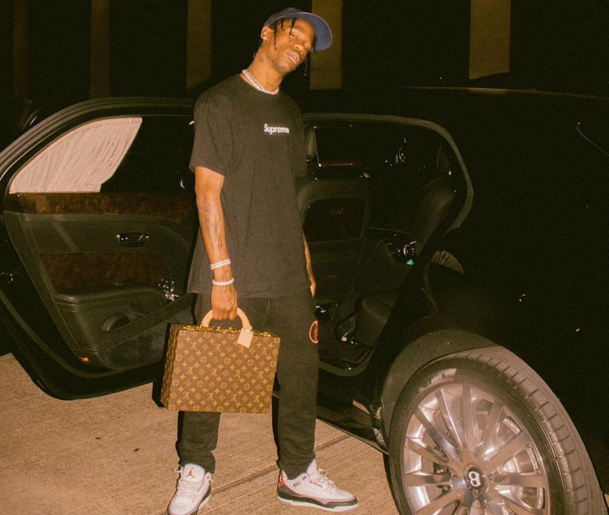 SPOTTED: Travis Scott Carries LV Briefcase while in Supreme & Jordan 3's
