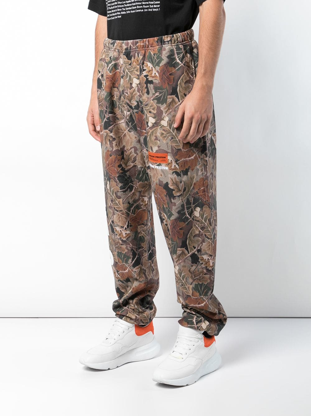HERON PRESTON leaf print track trousers