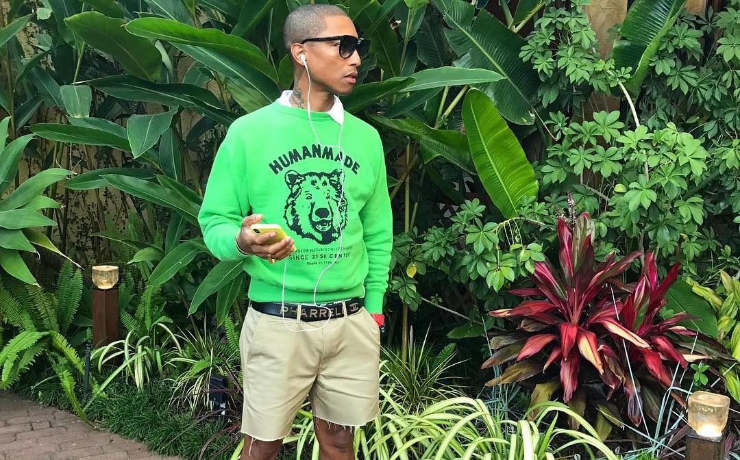 SPOTTED: Pharrell in Green Human Made Sweater & Hu Glide Sneakers