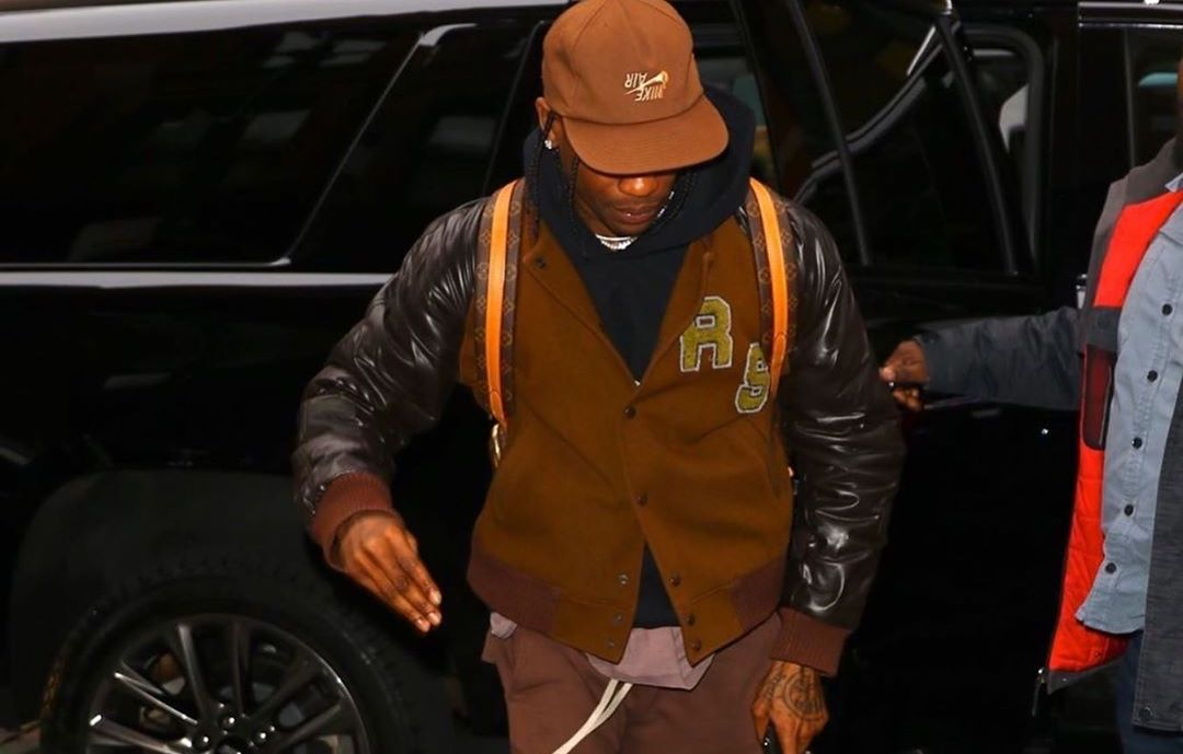 SPOTTED: Travis Scott Goes Mud Brown in Raf Simons Jacket
