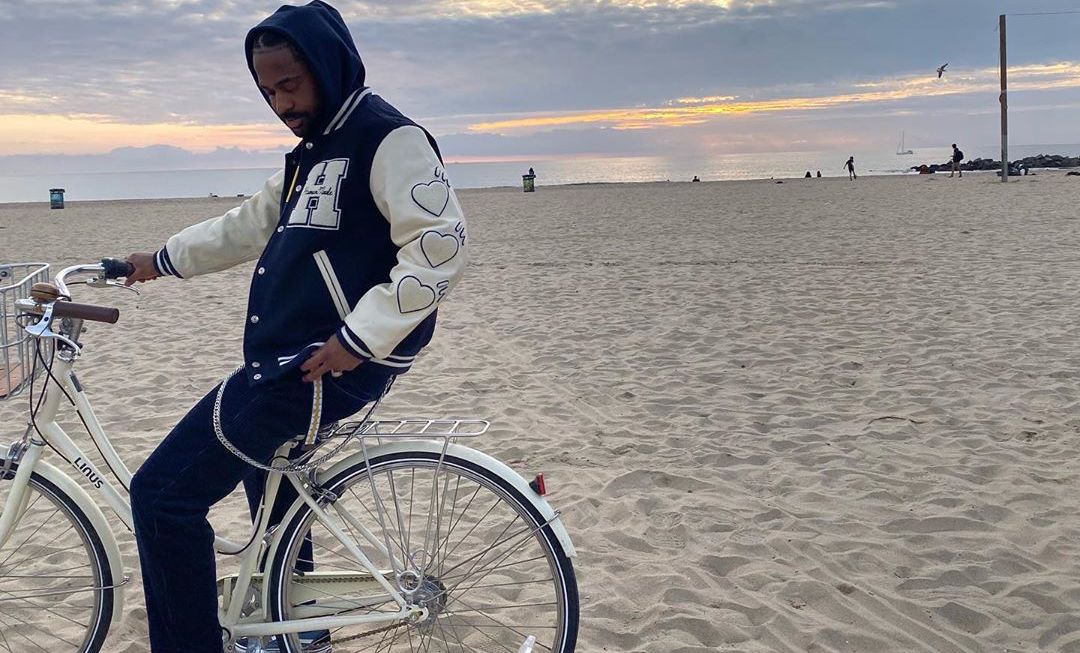 SPOTTED: Big Sean Hits The Beach In HumanMade Leather Jacket & Old Skool Vans