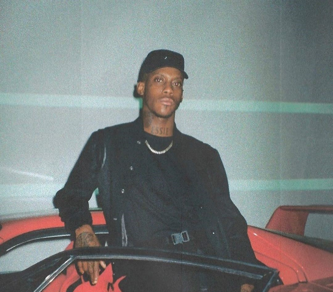 SPOTTED: Octavian Poses In-front of Ferrari in Monochrome Look