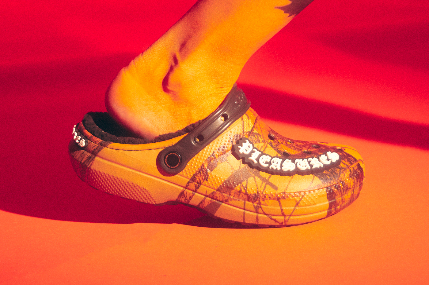 PLEASURES Re-Unite With Crocs for Camo Clogs