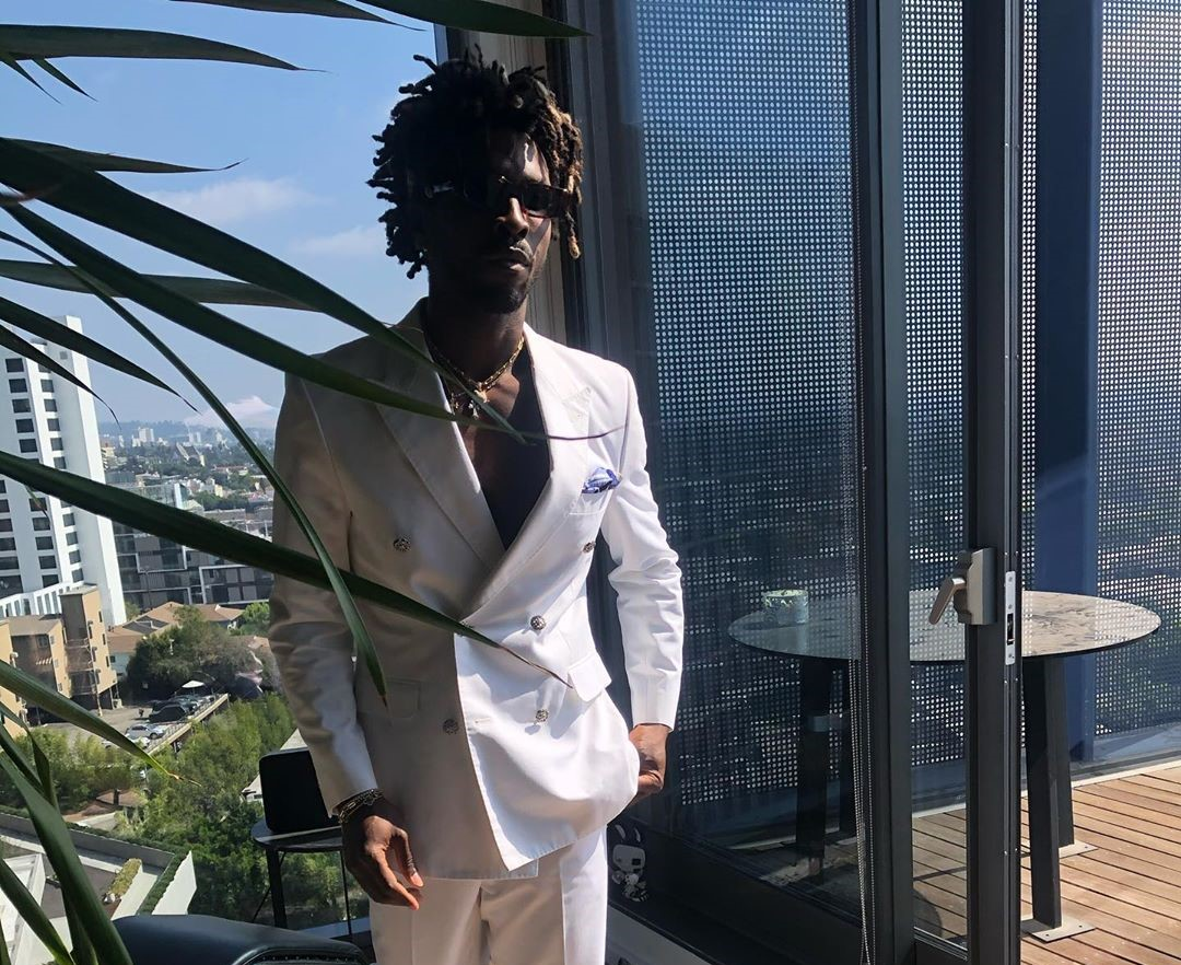 SPOTTED: Saint Jhn Goes Topless Under Double-Breated Suit