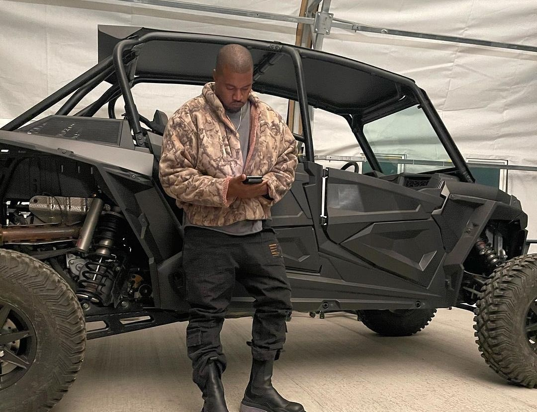 SPOTTED: Kanye Leans against his UTV in Tactical Fit