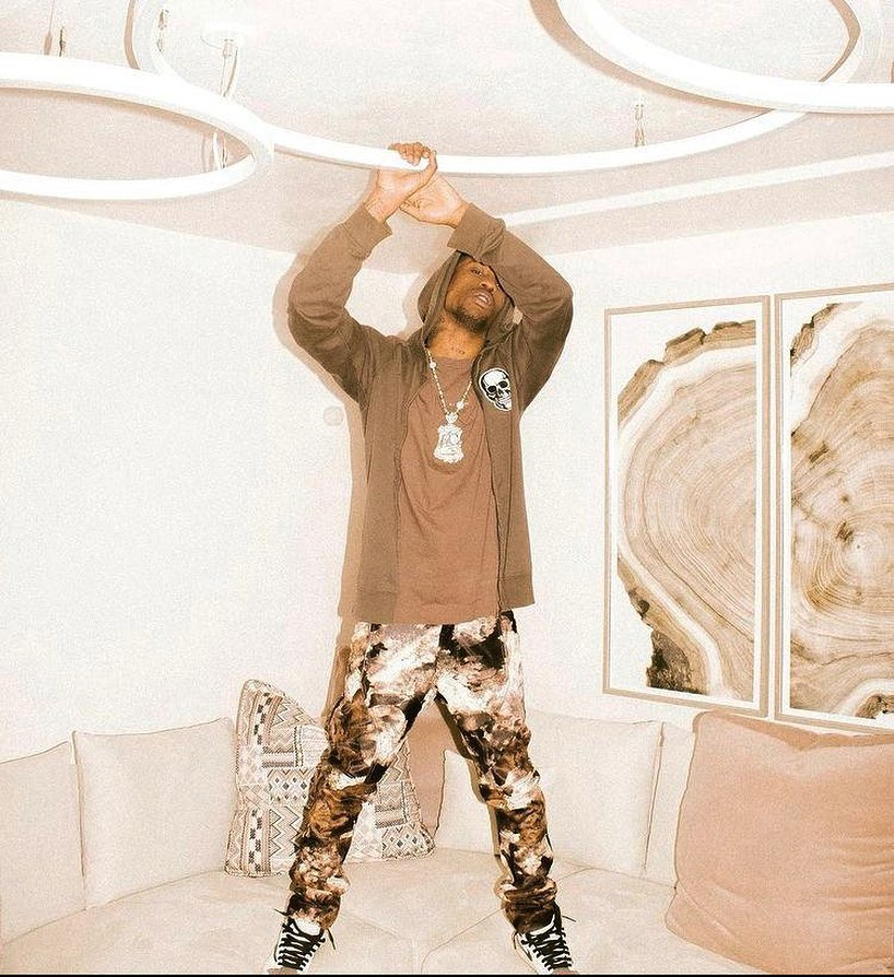 SPOTTED: Travis Scott Plays with Brown Hues
