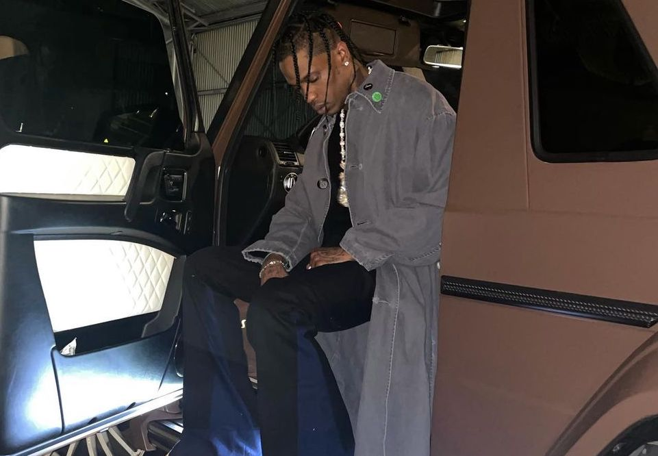 SPOTTED: Travis Scott rolls up in Raf Simons