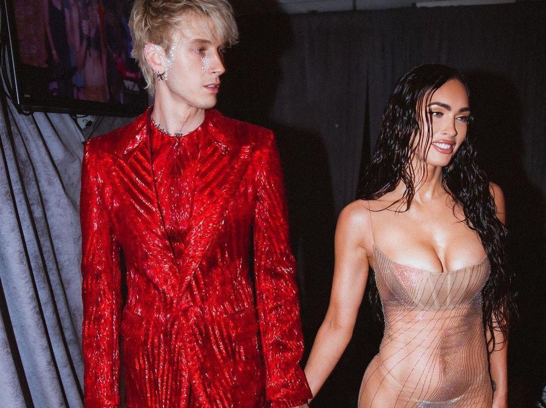 SPOTTED: Machine Gun Kelly attends VMAs in Glittering Berluti Suit